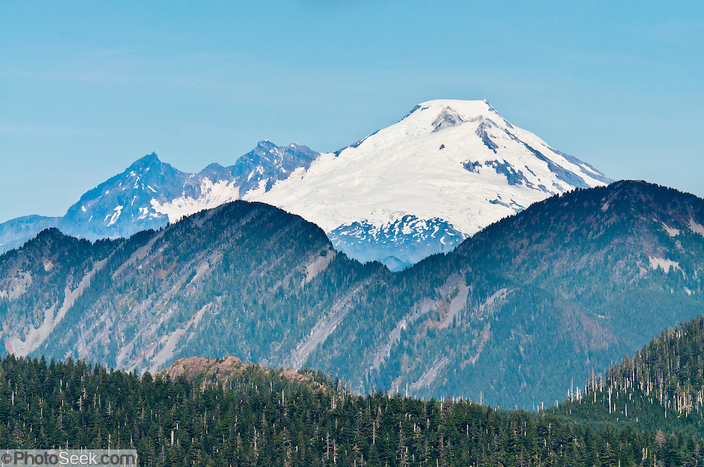 Mount Baker (10,781 feet) rises 40 miles north of a hike on Three Fingers Mountain in Boulder River Wilderness on Goat Flats Trail #641 from Tupso Pass trailhead to Tin Can Gap, Washington, USA.