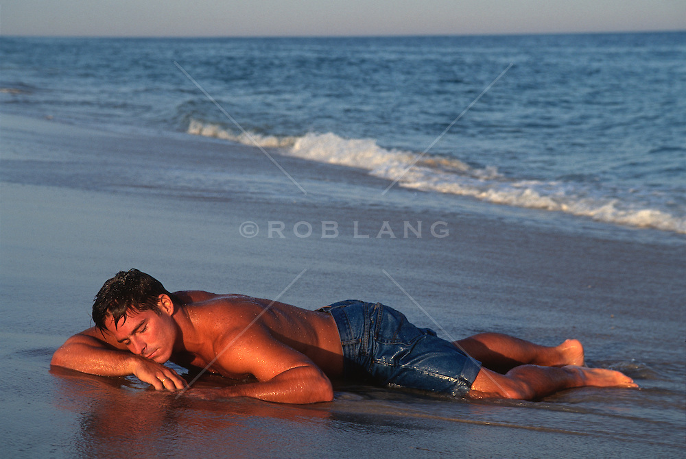 Wet Man resting on the shore of the beach