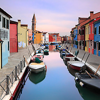 A classic view of a canal waterway in Burano, with its incredibly colourful fishermen's houses. Taken at sunset at the beginning of December.