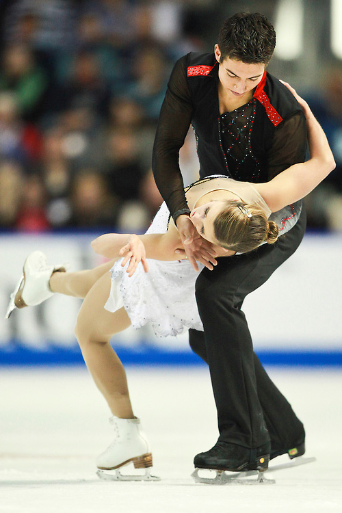 20101030 -- Kingston, Ontario -- Paige Lawrence and Rudi Swiegers of Canada skate to a third place finish in the pairs competition at Skate Canada International in Kingston, Ontario, Canada, October 30, 2010. <br /> AFP PHOTO/Geoff Robins