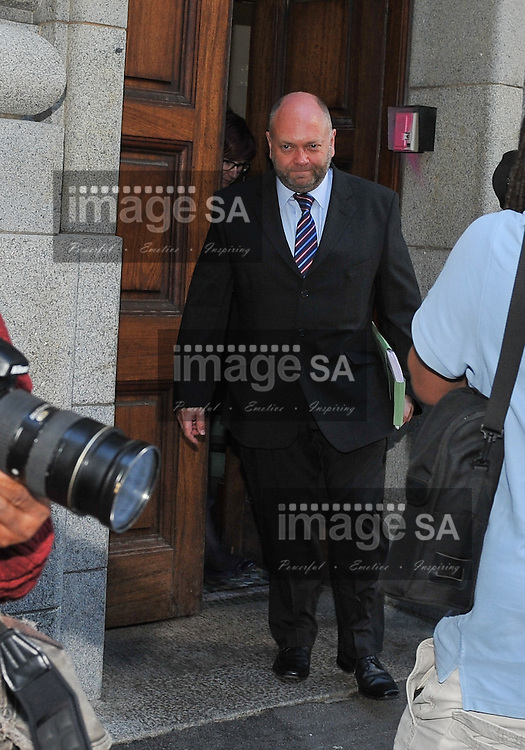 CAPE TOWN, SOUTH AFRICA - Monday 13 October 2014, Mark Roberts, former Metropolitan Police offer in the UK and now from the National Cyber Unit, leaves the court after testifying during Day 5 of the Shrien Dewani trial at the Western Cape High Court before Judge Jeanette Traverso. Dewani is caused of hiring hit men to murder his wife, Anni. Anni Ninna Dewani (n&eacute;e Hindocha; 12 March 1982 &ndash; 13 November 2010) was a Swedish woman who, while on her honeymoon in South Africa, was kidnapped and then murdered in Gugulethu township near Cape Town on 13 November 2010 (wikipedia).<br /> Photo by Roger Sedres
