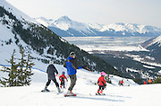 Alyeska Resort winter chairlift with skiers and snowboarders