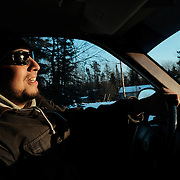 Fabian Blackhawk, a member of the leadership council, behind the wheel of his truck at the Ochiichagwe'Babigo'Ining Ojibway Nation reserve (also known as the Dalles First Nation) in Northern Ontario, Canada on 15 December 2016.