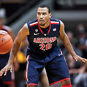 SHOT 1/21/12 6:39:25 PM - Arizona's Jordin Mayes #20 playes defense against Colorado during their PAC 12 regular season men's basketball game at the Coors Events Center in Boulder, Co. Colorado won the game 64-63..(Photo by Marc Piscotty / © 2012)
