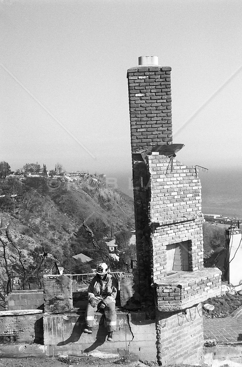 Firefire in the remains of a burnt home in Malibu, California (b&w)
