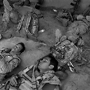 Exhausted Canadian infantry from the Vandoos (R22R) Bravo Company sleeping  in a civilian compound (home) occupied during the second of three days of fighting before continuing an operation to clear the area of insurgents in the Siah Choy area of Zhari District in Kandahar Province, Afghanistan. Zhari District (aka Zharey) located west of Kandahar City has long been an insurgent stronghold and the birthplace of the Taliban movement lead by Mullah Mohammad Omar in the 1990's. Cpl. Christian Bobbitt (foreground 2nd from left) age 23 and Sapper Matthieu Allard (rear far right) age 21 were killed by an IED about a month after this operation.