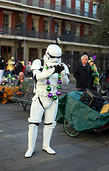 09 February 2016. New Orleans, Louisiana.<br /> Mardi Gras Day. A Storm Trooper at Jackson Square in the French Quarter.<br /> Photo&copy;; Charlie Varley/varleypix.com