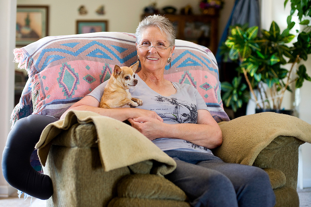 041712       Brian Leddy.Ellen Baca of Milan sits in her home with her dog Chiquita Tuesday afternoon. Baca is a survivor of neck lymphatic cancer.