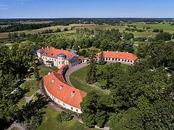 Kiltsi manor in Estonia. Aerial view, rooftop, green, trees. School. Old building, castle.