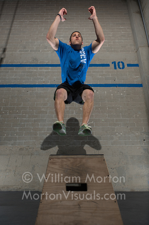 Fitness trainer Mike Gonzalez is photographed during a workout illustrating how Crossfit East Village supports your fitness goals. Advertising photography by Dallas commercial photographer William Morton of Morton Visuals.