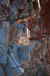 A shaft of sunlight strikes rocks near the Horizontal Waterfalls