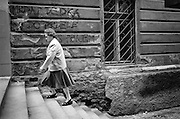 Woman walking up the stairs at Rokycanova street.