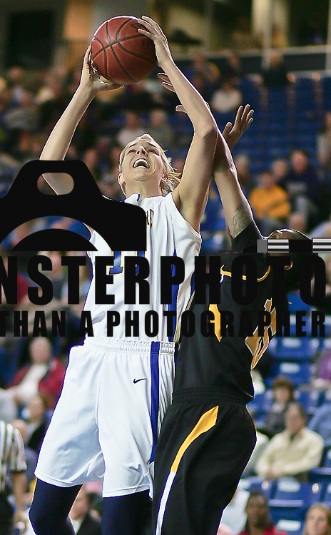 Delaware Forward (#11) Elena Delle Donne leads all scores with 15 points at the half of the Towson delaware game Wednesday at The Bob Carpenter Center In Newark Delaware Wednesday Night.<br /> <br /> Special to The News Journal/SAQUAN STIMPSON