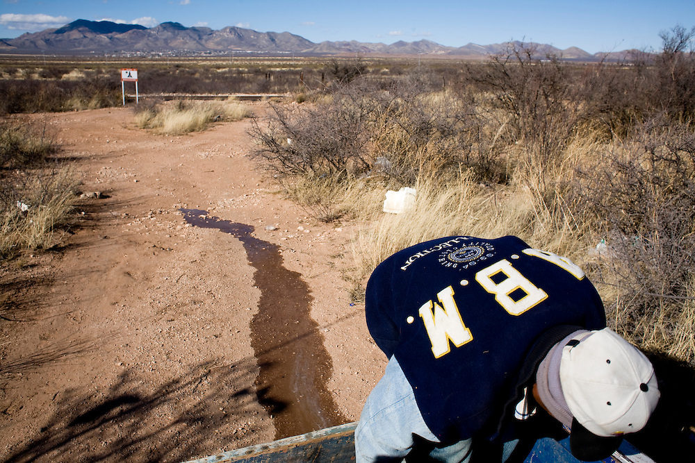 Esteban Perez, a volunteer with the Migrant Resource Center, drains water from a tank while filling water tanks in the desert near Naco, Sonora, Mexico, on Wednesday, Jan. 30, 2008. MRC is a bi-national project of Citizens for Border Solutions (Bisbee, AZ) and Iglesia del Camino (Naco, Mexico), with support of other organizations and individuals.