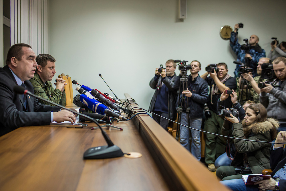 DONETSK, UKRAINE - FEBRUARY 2, 2015: Igor Plotnitsky, left, the head of the Luhansk People's Republic, and Aleksandr Zakharchenko, second from left, head of the Donetsk People's Republic, hold a joint news conference in Donetsk, Ukraine. With peace talks scheduled in the Belarussian capital of Minsk over the weekend that never got underway, the two leaders stated that their representatives refused to participate due to the fact that  Ukraine sent as their representative Leonid Kuchma, a former president of Ukraine with no current government post. CREDIT: Brendan Hoffman for The New York Times