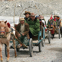 Tourists being carried by cart up to Mt. Everest Base Camp, Rongphu, Tibet. 8/14/2005.