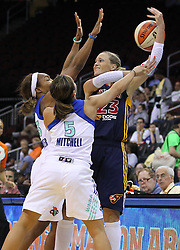 June 3, 2012; Newark, NJ, USA; Indiana Fever forward Katie Douglas (23) passes the ball while being defended by New York Liberty guard Leilani Mitchell (5) and New York Liberty guard Cappie Pondexter (23) during the second half at the Prudential Center. The Liberty defeated the Fever 87-72.