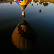Randy Fuehrer of McMinnville, Ore. and Brian Carlson of Prosser perform a splash and dash on Friday as the 22nd annual Great Prosser Balloon Rally kicked off at the Prosser Airport. The event continues Saturday and Sunday, weather permitting, starting at 6 a.m. each day, and a night glow on Saturday night at 5:30 p.m. at Art Fiker Stadium in Prosser. About 30 balloons are participating in this year's rally. For a full schedule, visit prosserballoonrally.org.