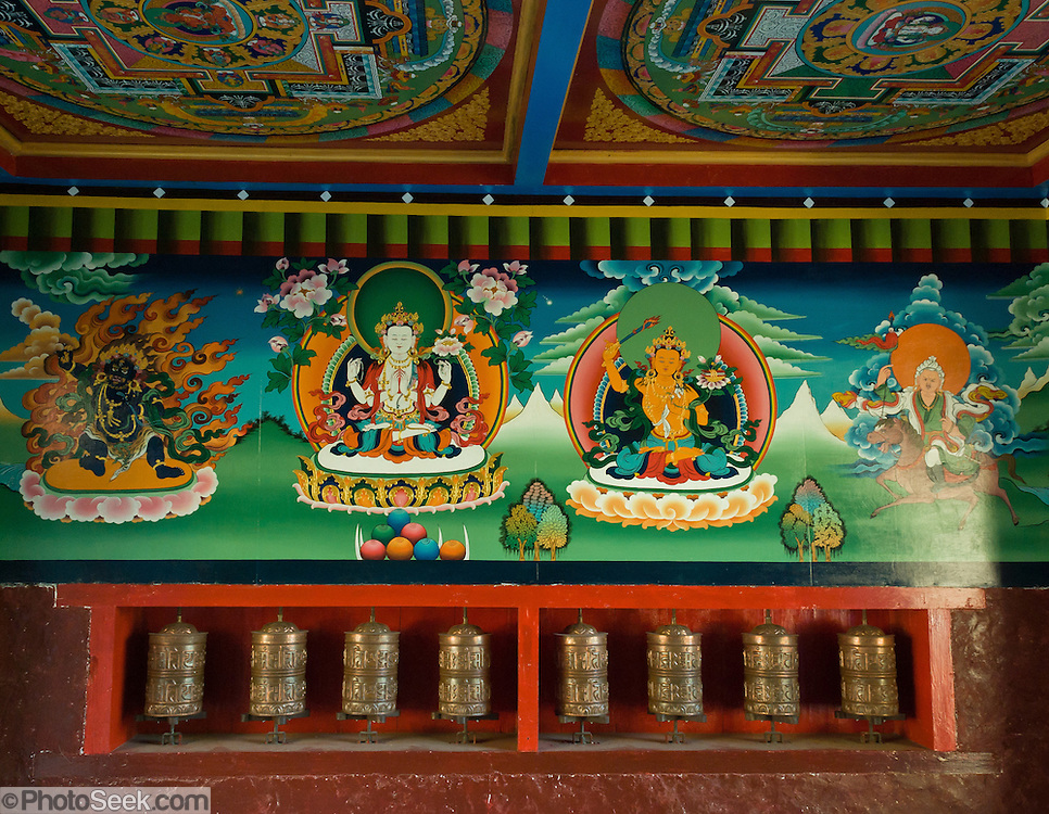 Tibetan Buddhist art and prayer wheels inside the monument for entrance/exit to Sagarmatha National Park, located between Monjo (Manjo) and Jorsale, along the Dudh Khoshi (or Kosi) river, in eastern Nepal. Sagarmatha National Park was created in 1976 and honored as a UNESCO World Heritage Site in 1979.