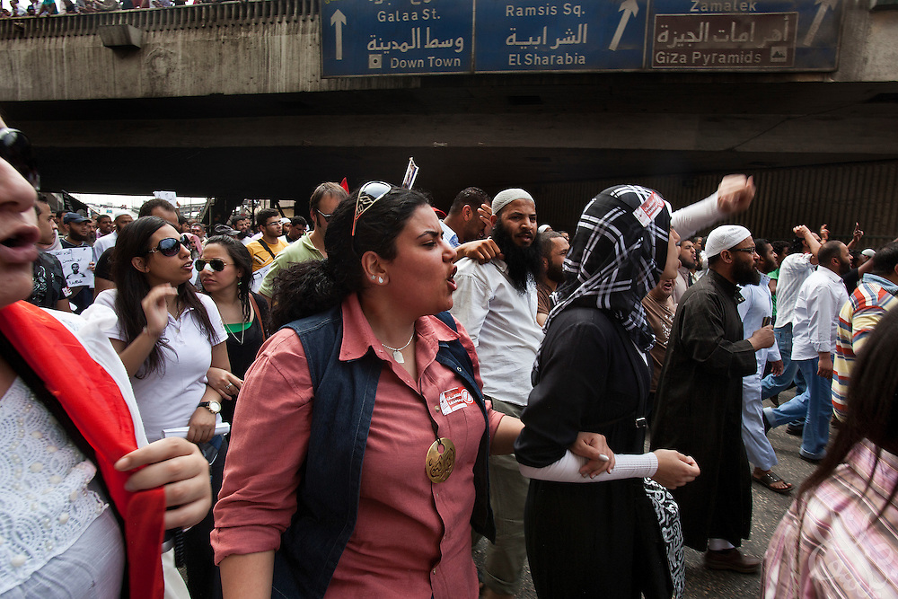 """Youth for Justice and Freedom"" activist Omneya Atallah, (C) age 23, marches  with a mix of revolutionary youth and salafist groups through the Abbasiya district during May 4, 2012 demonstrations against the ruling Supreme Council of the Armed Forces (SCAF) near the Defense ministry building in Cairo, Egypt. Although the various groups draw from different ends of the political spectrum, they have managed to find common ground in demonstrations against the Supreme Council of Armed Forces (SCAF) and in their support of Egyptian Islamist presidential candidate Abdul Moneim Aboul Fotouh."