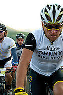 Lance Armstrong contemplates the mileage and elevation gain that lie before him as he and the rest of the competitors roll through Historic Downtown Crested Butte.