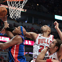 30 October 2010: Detroit Pistons Charlie Villanueva is fouled by Chicago Bulls Taj Gibson, next to Joakim Noah during the Chicago Bulls 101-91 victory over the Detroit Pistons at the United Center, in Chicago, Illinois, USA.