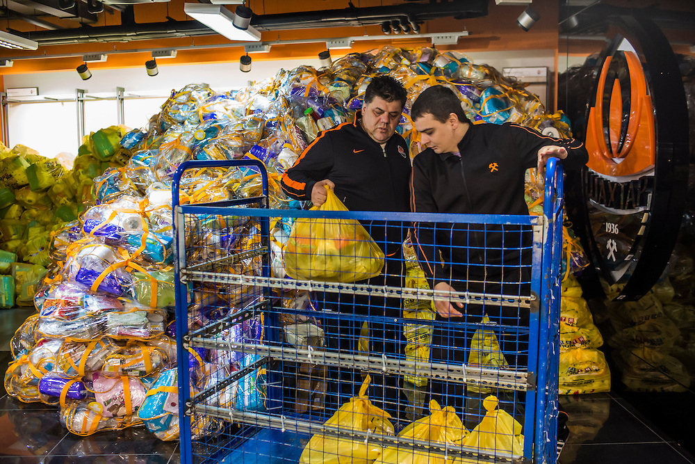 DONETSK, UKRAINE - JANUARY 26, 2015: Bags of food and other supplies are taken for distribution to residents in need at the Donbass Arena soccer stadium in Donetsk, Ukraine. With many residents finding it difficult to access bank accounts or find work, humanitarian needs are rising. CREDIT: Brendan Hoffman for The New York Times