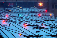 Trains wait to depart the Ogilvy Transportation Center in Chicago during a heavy snowstorm.