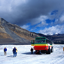 Tourists walking on the Columbia Icefield, Jasper National Park. This glacial is melting fast.