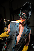 Rory McKernan braves the torch in a welding booth at Rogue Fitness in Columbus, OH.
