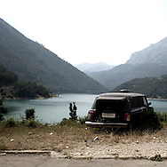 a car for the dead abandoned on a mountain.There are several arguments about the derivation of the name  &quot;Montenegro&quot;, one of these relates to dark and deep forests  that once covered the Dinaric Alps, as it was possible to see them from the sea. <br />