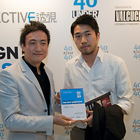 Architect Arthur Huang (R) receives his 40 Under 40 Perspective magazine award.