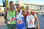 BELLVILLE, SOUTH AFRICA - Wednesday 3 December 2014, (l-r) Sythilo Diko 3rd place, Unathi Nteta 1st place and Duran Byman 2nd place during the Metropolitan 10km road race outside the Parc Du Cap head office in Bellville.<br /> Photo by IMAGE SA / Roger Sedres