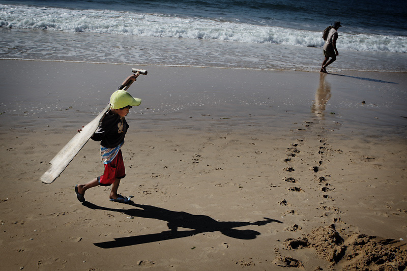 Muine. A fisherman and his son is walking on the beach after they have finished the fishing.