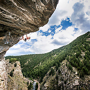 Sophia Di Biase on Mighty Dog, 5.12c, at The Doghouse in Clear Creek Canyon, Golden, CO. Kris Ugarriza - Red Wave Pictures