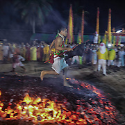 Devotees to the Chinese shrine of Tae Gun Tae Tai gather prior to fire walking ceremonies at the annual Vegetarian Festival in Phuket, Thailand, Saturday , Oct. 12, 2013. The a traditional Chinese vegetarian festival  emphasizes merit making and ritual cleansing of the body to mark the nine-day-long festival.  It also features face-piercing, spirit mediums, and strict vegetarianism.