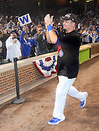 CHICAGO, IL - OCTOBER 12:  Kyle Schwarber #12 of the Chicago Cubs celebrates with fans after Game 3 of the NLDS against the St. Louis Cardinals at Wrigley Field on Monday, October 12, 2015 in Chicago , Illinois. (Photo by Ron Vesely/MLB Photos via Getty Images) *** Local Caption *** Kyle Schwarber