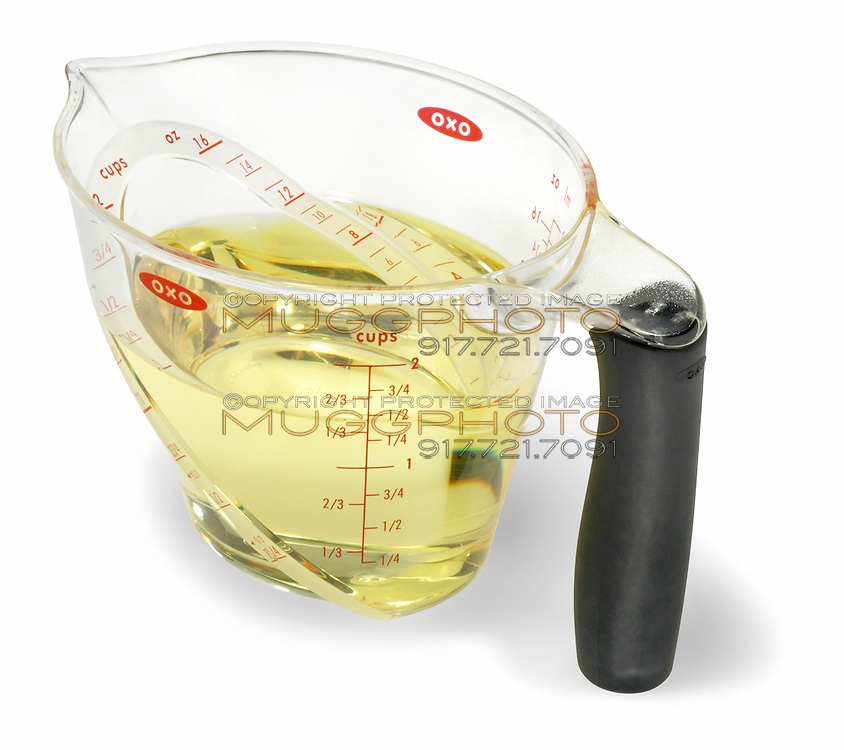 oxo measuring cups full of baking oil