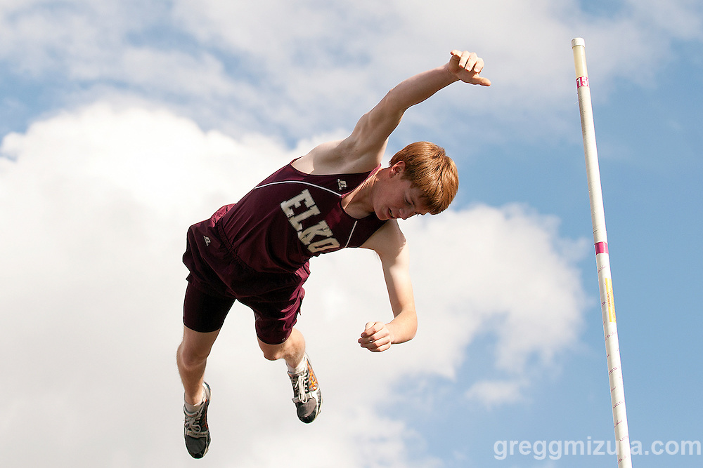 Elko senior Brendan Shelley attempts his final vault during the YMCA Track & Field Invitational on April 26, 2014 at Bishop Kelly High School, Boise, Idaho. Shelley did not make this attempt but but he did win the event with a height of 14-00.00.