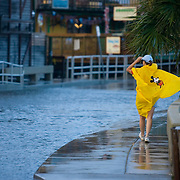A Cedar Key, Florida resident makes her way down a road flooded by the surge from  Tropical Storm Alberto June13, 2006. REUTERS/Scott Audette