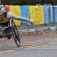 (Wellesley, MA - 4/20/15) Women's wheelchair champion Tatyana McFadden, left, races past Wellesley College during the Boston Marathon, Monday, April 20, 2015. Staff photo by Angela Rowlings.