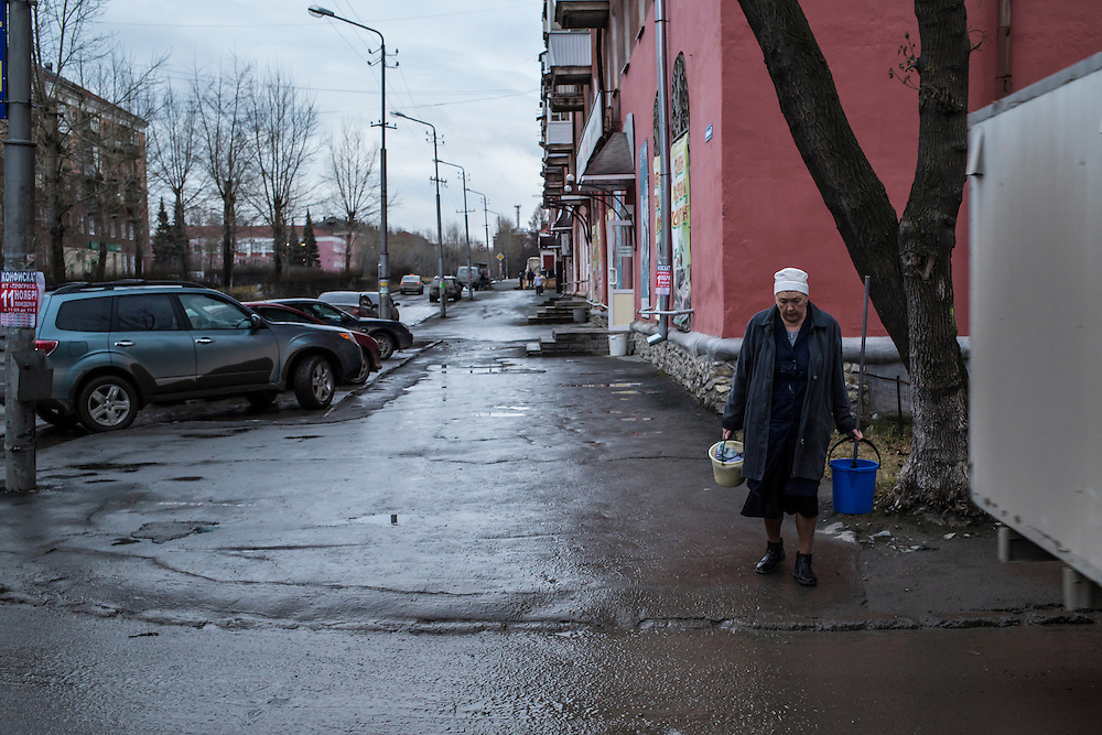 A woman walks on the town's main street on Monday, November 11, 2013 in Asbest, Russia.