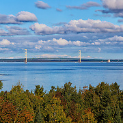 &quot;Measured Distance&quot;<br /> <br /> From high above the trees, you get a wonderful view of the Mackinac Bridge in the straits of Mackinac!<br /> Gorgeous blue water and skies dotted with puffy clouds complete the image!!<br /> <br /> The Great Lakes by Rachel Cohen
