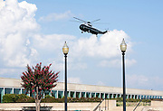 Marine one prepares to land with U.S. President Barack Obama and First Lady Michelle Obama before a remembrance ceremony at the Pentagon in Washington, DC, on Sunday, Sept. 11, 2011. Photographer: Joshua Roberts/SIPA