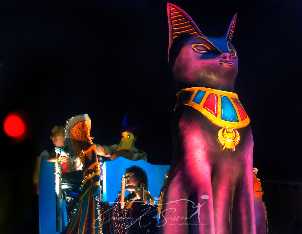 """A large cat towers over the Egypt float during the Order of the Polka Dots Mardi Gras parade in downtown Mobile, Ala. Feb. 24, 2011. The Polka Dots celebrated their 62nd year with the theme, """"Polka Dots Traveling the World."""" An estimated 29,161 people attended the parade in Mobile, which claims to have the oldest carnival celebration in the United States, dating back to 1703. (Photo by Carmen K. Sisson/Cloudybright)"""