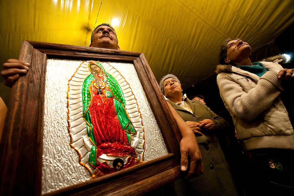 Catholics hold an impromtu mass in front of the Sante Muerte shrine in Tipito to protest against the spreading cult.