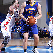 Santa Cruz Warriors Center Ognjen Kuzmic (32) attempts a shot near the basket as Delaware 87ers Forward Drew Gordon (32) defends in the second half of a NBA D-league regular season basketball game between the Delaware 87ers and the Santa Cruz Warriors (Golden State Warriors) Tuesday, Jan. 13, 2015 at The Bob Carpenter Sports Convocation Center in Newark, DEL