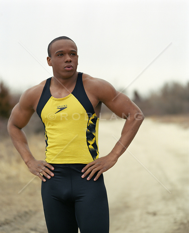 African American runner on a dirt road in East Hampton, NY
