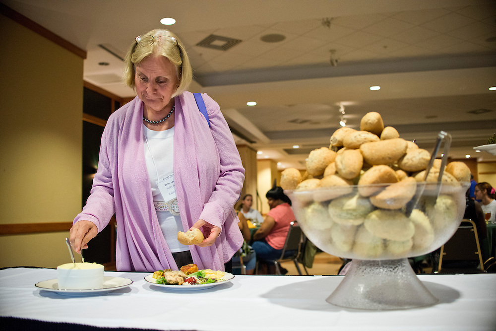 (photo by Matt Roth).Friday, July 20, 2012..Dr. Betsy Lawrence fills up her plate during the President's Banquet at The Forum in Decker College Center during McDaniel College's Parent Preview Friday, July 20, 2012.
