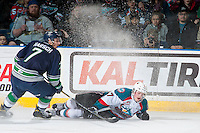 KELOWNA, CANADA - FEBRUARY 13: Reece Harsch #7 of the Seattle Thunderbirds checks Lucas Johansen #7 of the Kelowna Rockets during first period on February 13, 2017 at Prospera Place in Kelowna, British Columbia, Canada.  (Photo by Marissa Baecker/Shoot the Breeze)  *** Local Caption ***